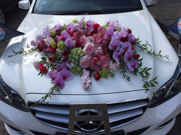 Flower wreath on car
