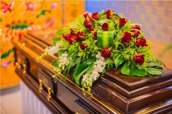 Flowers and wreath on coffin